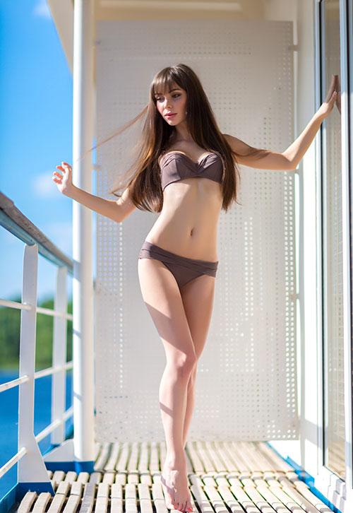Escort in bikini enjoying her favorite vacation spot