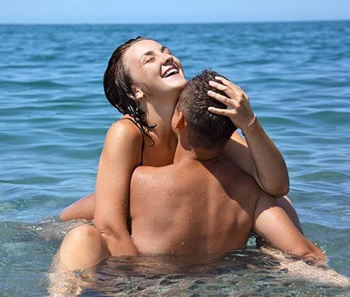 Couple having sex on a nude beach