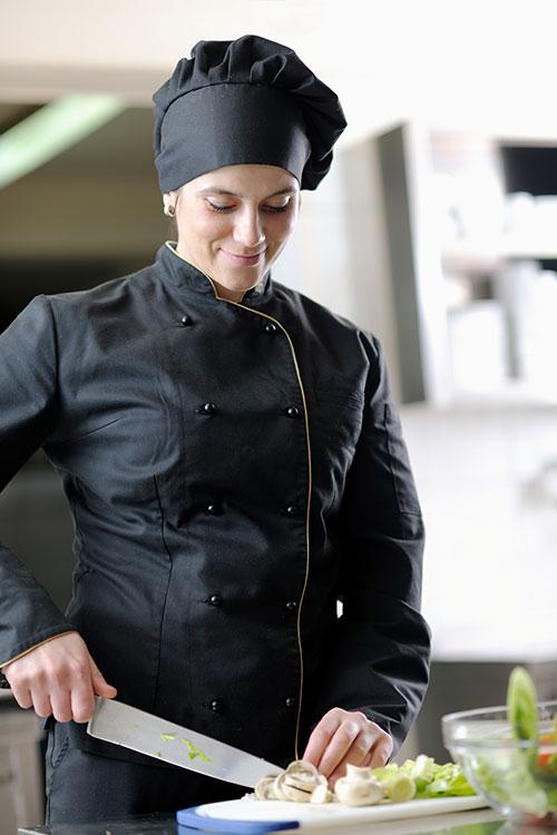 Chef preparing food at adult resort